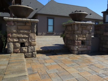 These are stacked stone pillars on stamped concrete patio in Folsom