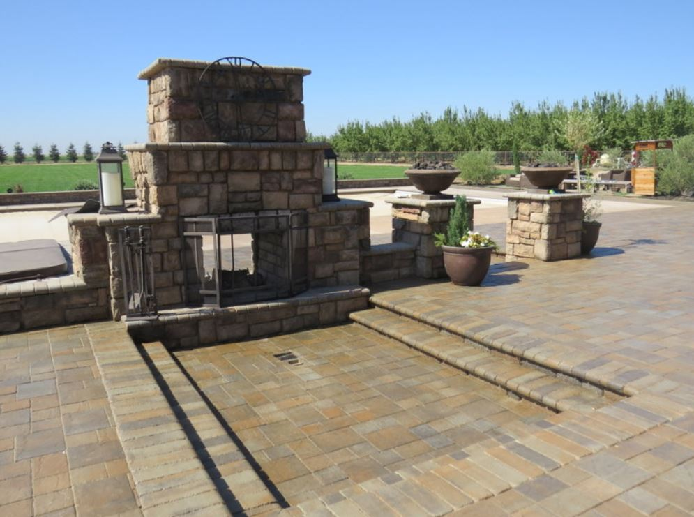 fireplace built by a roseville masonry contractor. It is a stacked stone fireplace